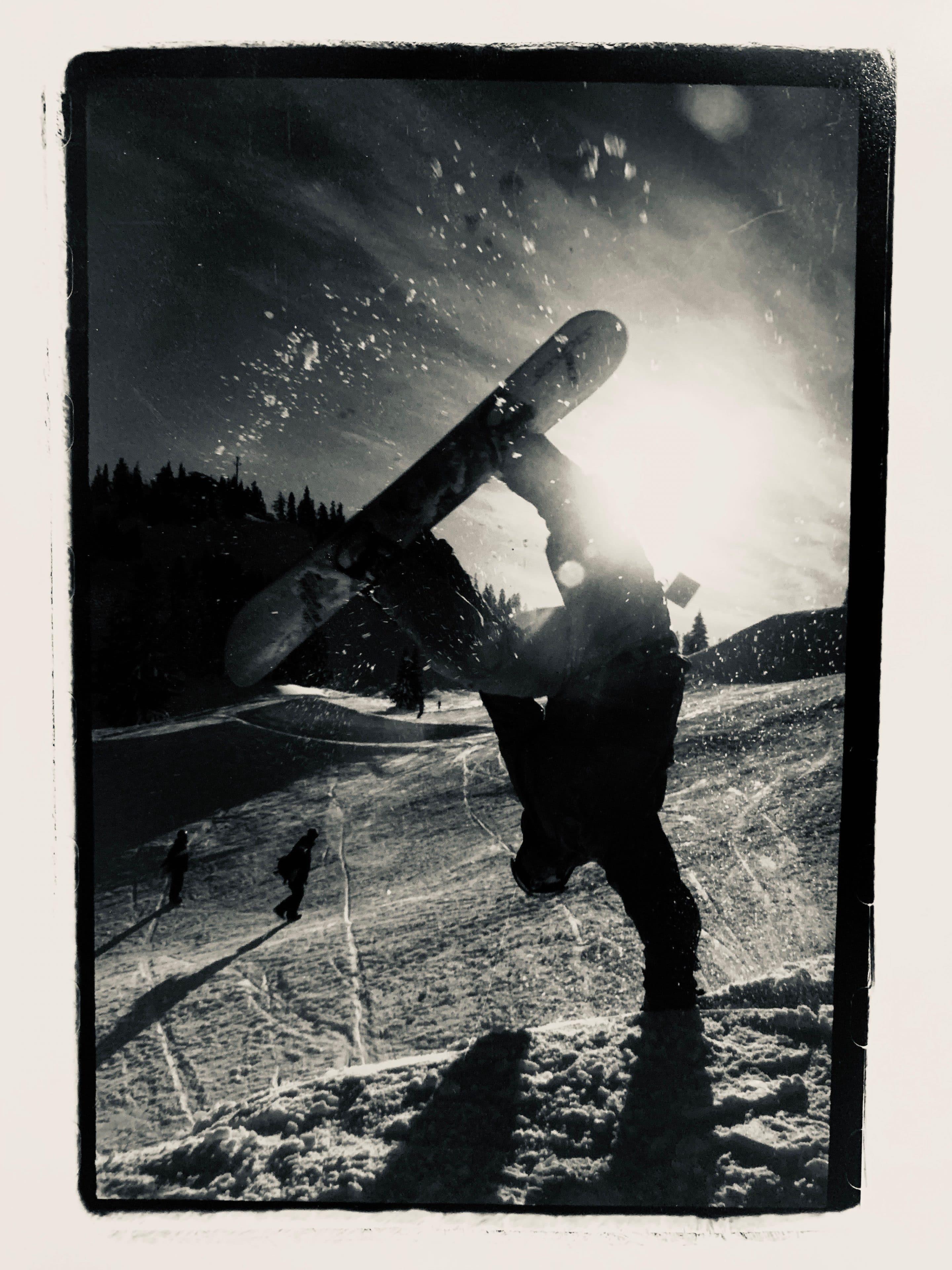 Dr. Iversen does a sick snowboarding trick on a ski slope in Washington.